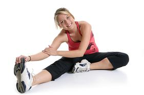 A woman stretching before she  exercises.