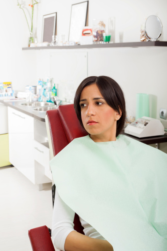 Woman nervous about her dental procedure in need of sedation at Beautiful Smiles in Woodland, CA