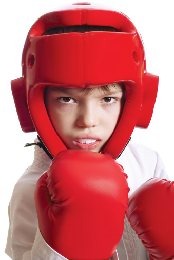 Kid in boxing gear with mouth guard from Beautiful Smiles - James Yang, DDS in Woodland, CA
